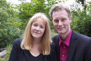 Julie & Gernot smiling portrait in park